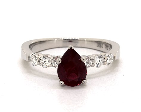 1.23 carat ruby pear shaped side stones engagement ring in