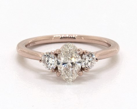 0 76 Carat Oval Cut Three Stone Engagement Ring In 14k Rose Gold