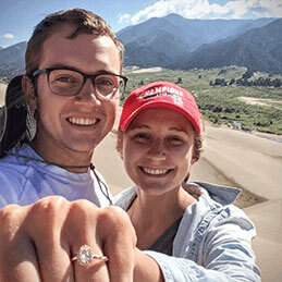 a couple showing their ring