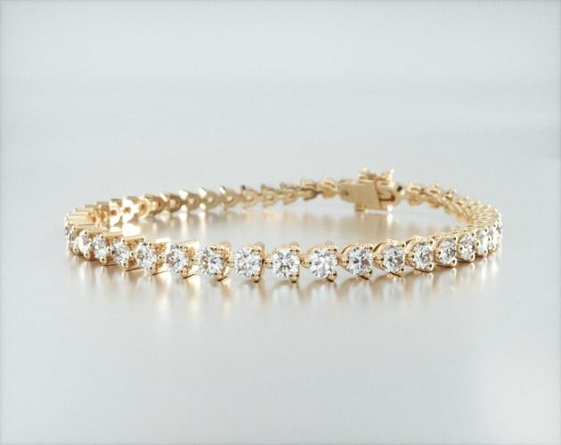14K Yellow Gold Three Prong Flower Clasp Diamond Tennis Bracelet (5 CTW)