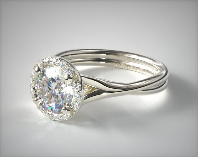 Platinum Pave Halo Twisted Shank Solitaire