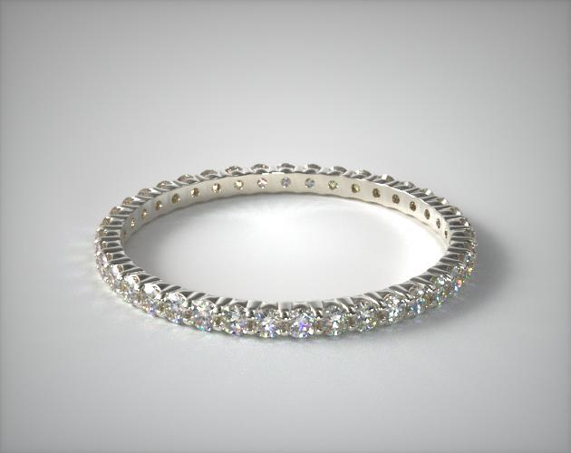 18K White Gold Ladies 0.50CTW.* Contoured Common Prong Diamond Eternity Ring