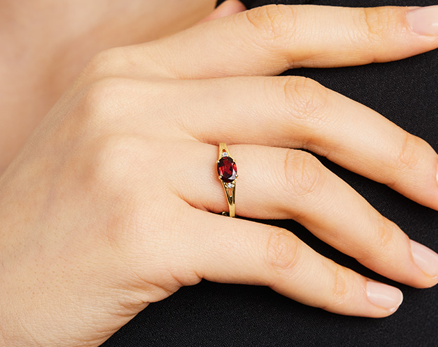 Yellow Gold Oval Garnet And Diamond Accent Birthstone Ring