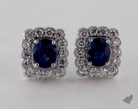 18K White Gold Diamond Framed 0.95tcw Oval Blue Sapphire Earrings.